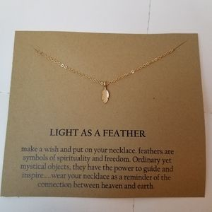 Jewelry - Feather pendant charm necklace